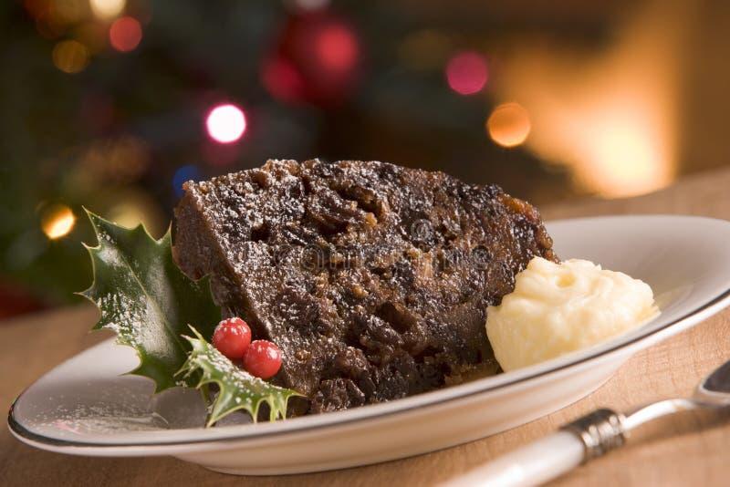 Partie de pudding de Noël avec du beurre d'eau-de-vie fine photos libres de droits