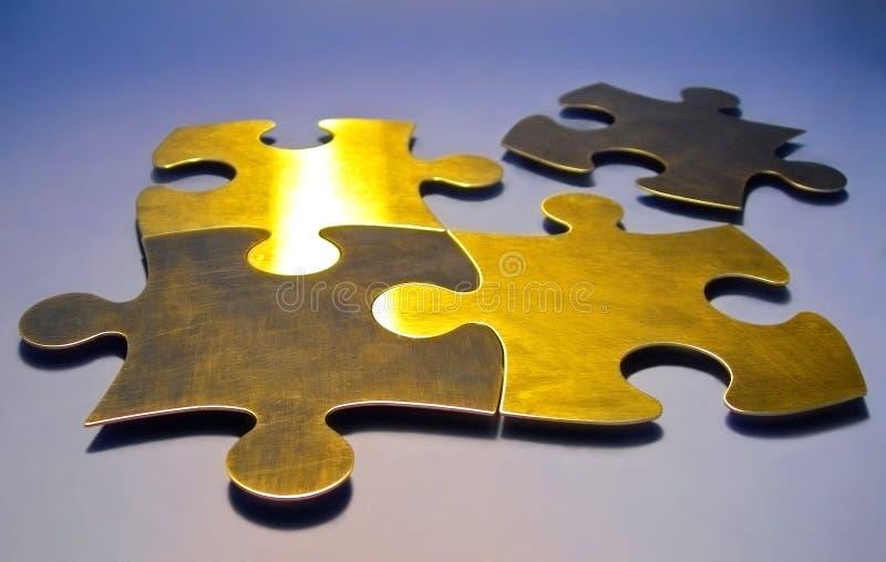 Parties d'or de puzzle photographie stock libre de droits