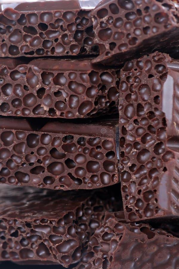 Parties de chocolat. image stock