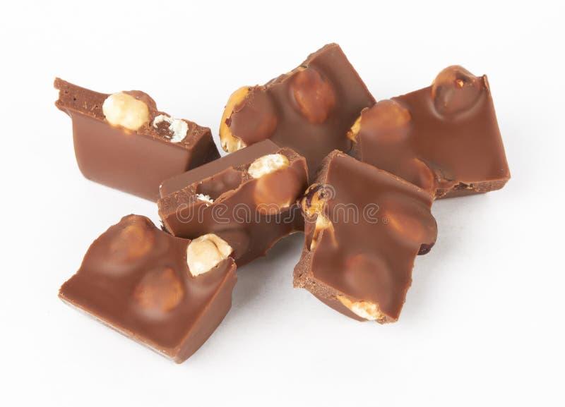 Parties de chocolat avec la noix image stock