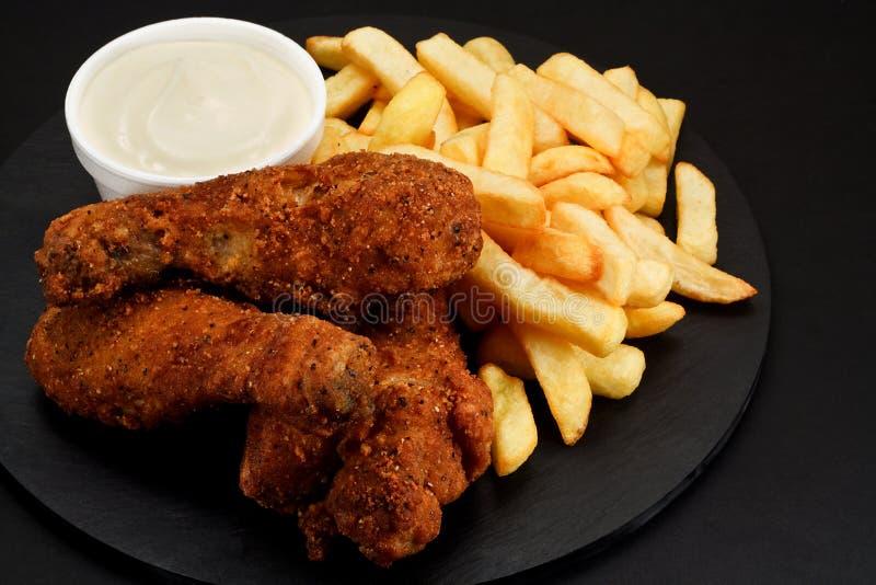 Parties de poulet frit méridional image libre de droits
