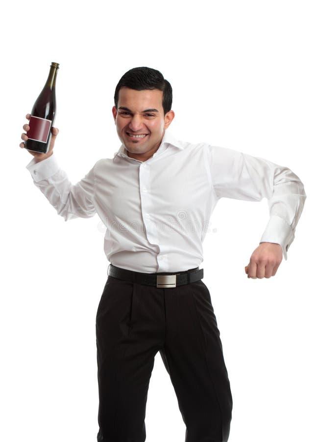 Partij goer met wijnfles het vieren royalty-vrije stock foto