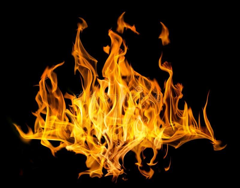 Partij van gele brandvonken op zwarte royalty-vrije stock afbeelding