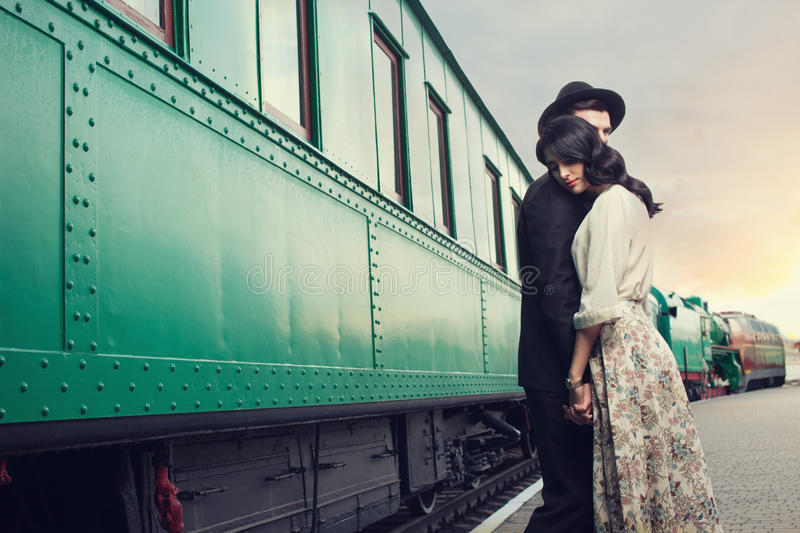 Parting of lovely couple. On railway station stock photos