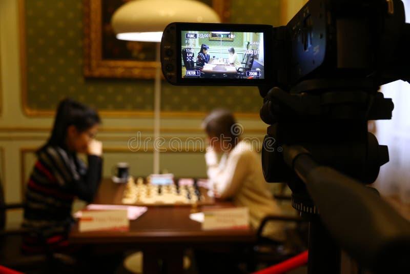 Partita Mariya Muzychuk di campionato di scacchi del mondo delle donne di FIDE contro Hou Yifan fotografia stock