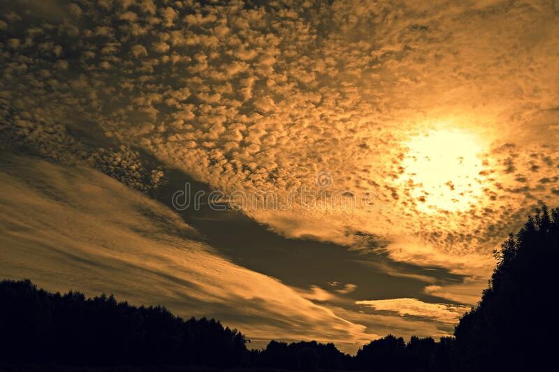 Partly clouded sky at sunset stock photography