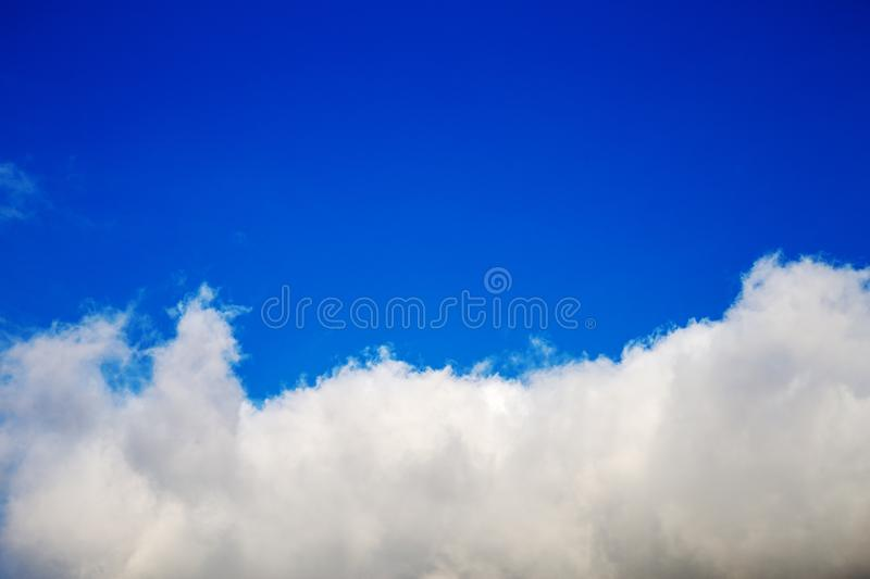 Partly cloudy sky. Blue sky. Bright sky. Background royalty free stock photography