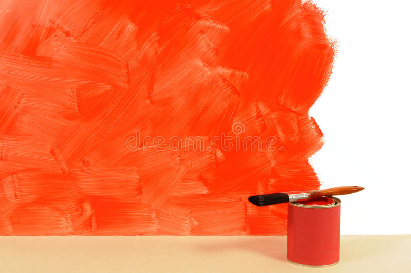 Painting red wall, home decorating, paint tin, paintbrush, copy space royalty free stock image