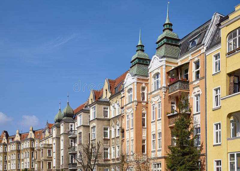 Tenements in Szczecin Stettin city, Poland. Partly renovated tenements at Slowackiego Street in Szczecin Stettin city on a beautiful spring day,  Poland royalty free stock images
