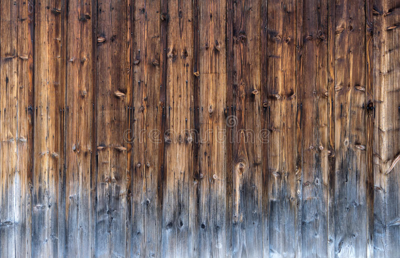 Partly weathered wooden facade stock images