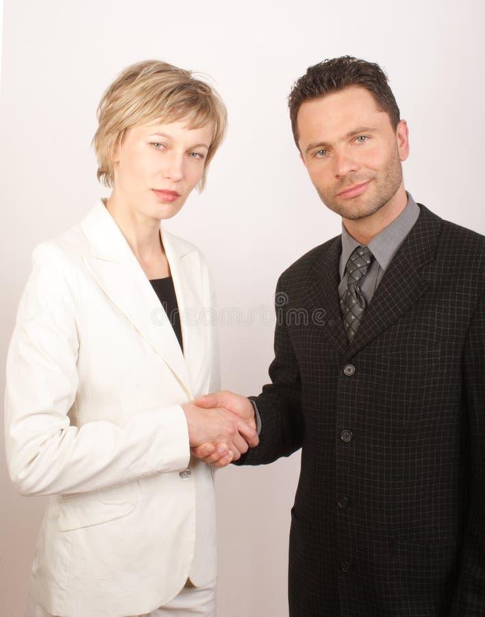 Partnering da mulher do homem de negócio imagem de stock