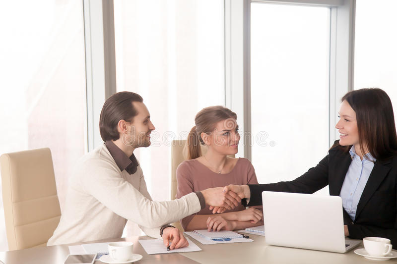 Partners handshaking on business meeting at office, discussing w stock photos