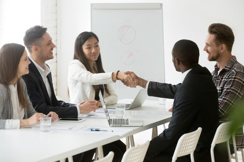 Partners handshaking after successful work negotiations stock images
