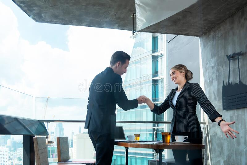 Partners man and women  joining hands to success together. Business Team stack of hands for star up project and sign agreement con royalty free stock image
