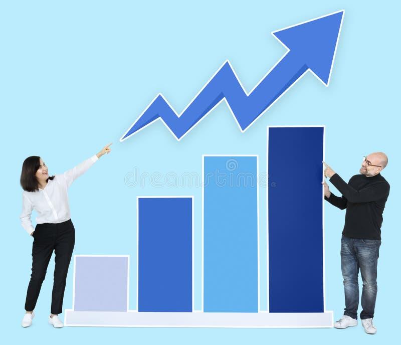 Partners met een het groeien grafiek stock afbeeldingen