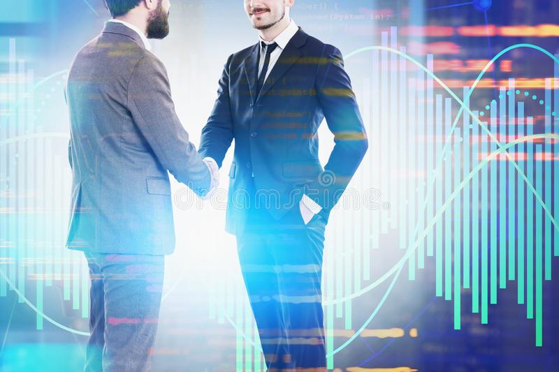 Partners shaking hands, lines of code and graphs. Two men shaking hands over blurred background with lines of code and graphs. Concept of hi tech startup and stock illustration