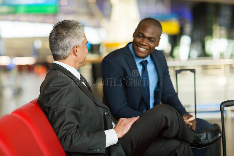 Partners waiting airport stock photography