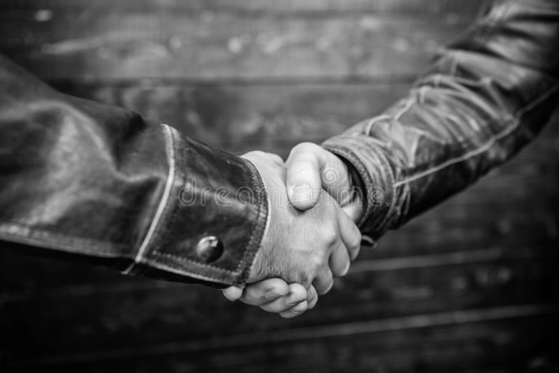 Partnership and business deal. Successful deal handshake. Handshake approving sign. Agreement compromise arrangement. Shaking hands close up. Handshake stock photos