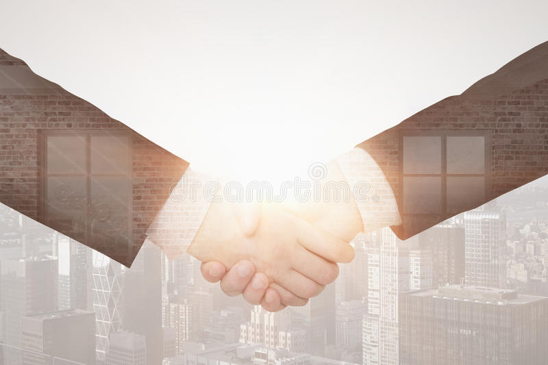 Partnership concept. Close up of handshake on creative city background. Double exposure. Partnership concept royalty free stock photo