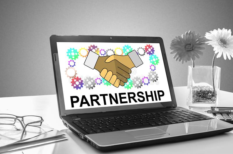 Partnership concept on a laptop screen. Laptop screen showing partnership concept royalty free stock image
