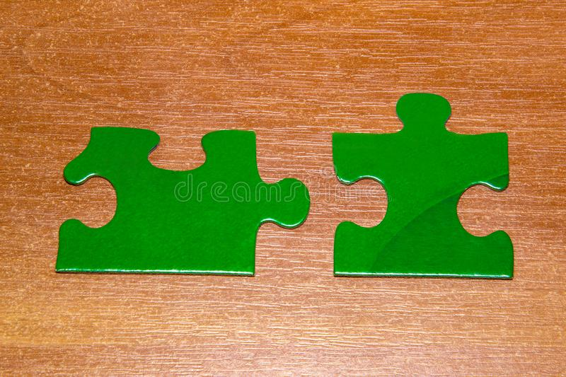 Partnership concept with puzzle pieces together on wooden background royalty free stock image