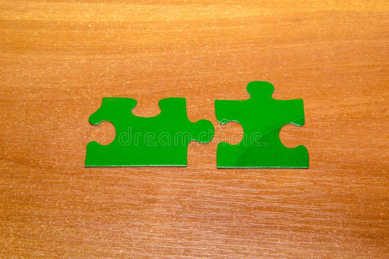 Partnership concept with puzzle pieces together on wooden background stock photography