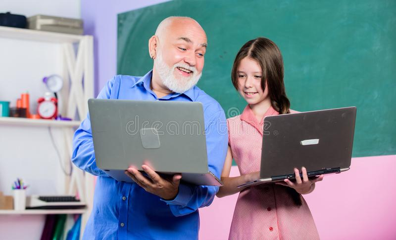 Partnership in discovery. small girl with man tutor study on computer. school lesson online. Search engine. new stock images