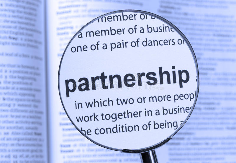 Partnership. Highlighted thru a magnifying glass royalty free stock photo