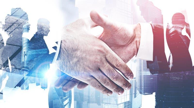 Partnership and teamwork, handshake in city royalty free stock image