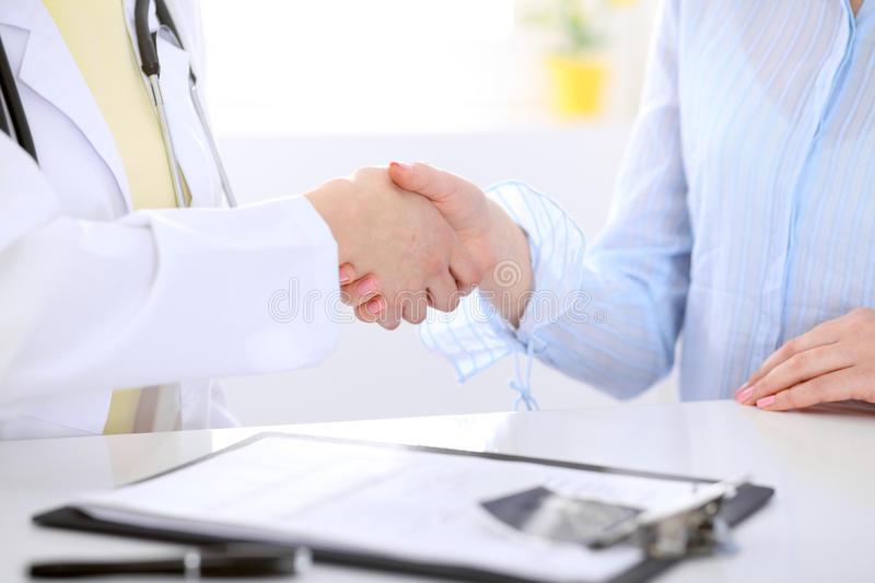 Partnership, trust and medical ethics concept. In health care stock image