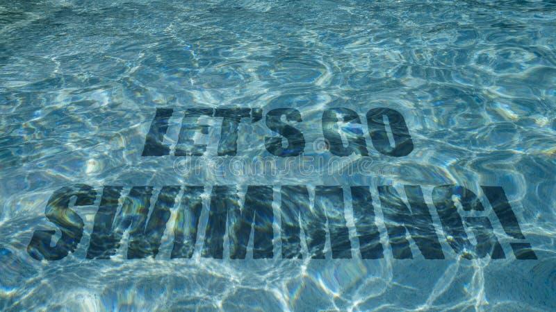 Partons nager le texte paraissant sous l'eau dans une piscine images libres de droits