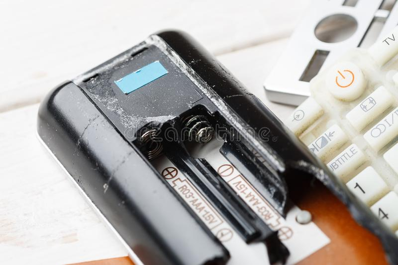 Parts of broken tv remote control on a white table, closeup royalty free stock photography