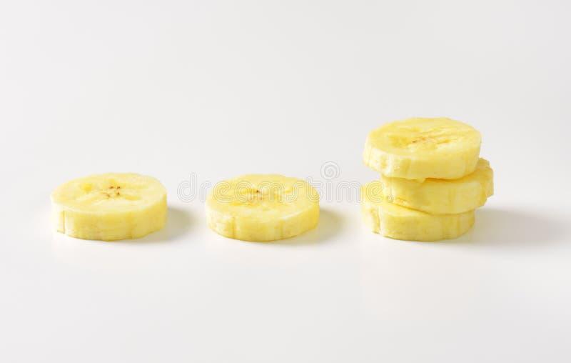 Parts de banane photographie stock