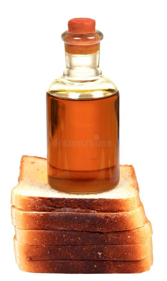 Parts de pain et huile d'olive photo libre de droits