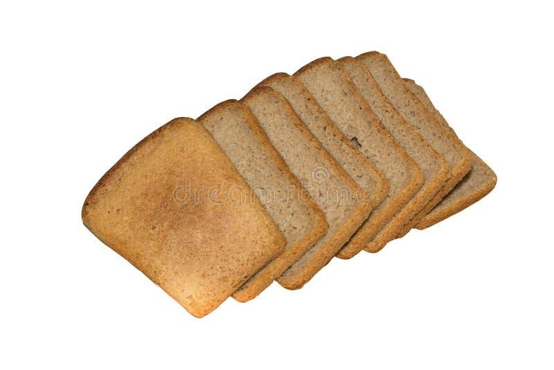 Parts de pain noir d'isolement sur le blanc photos stock
