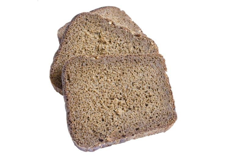 Parts de pain noir d'isolement sur le blanc photographie stock libre de droits
