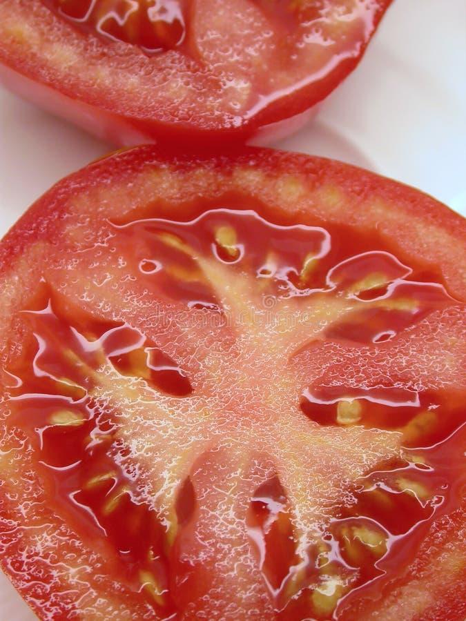 Parts De Tomate Photos stock