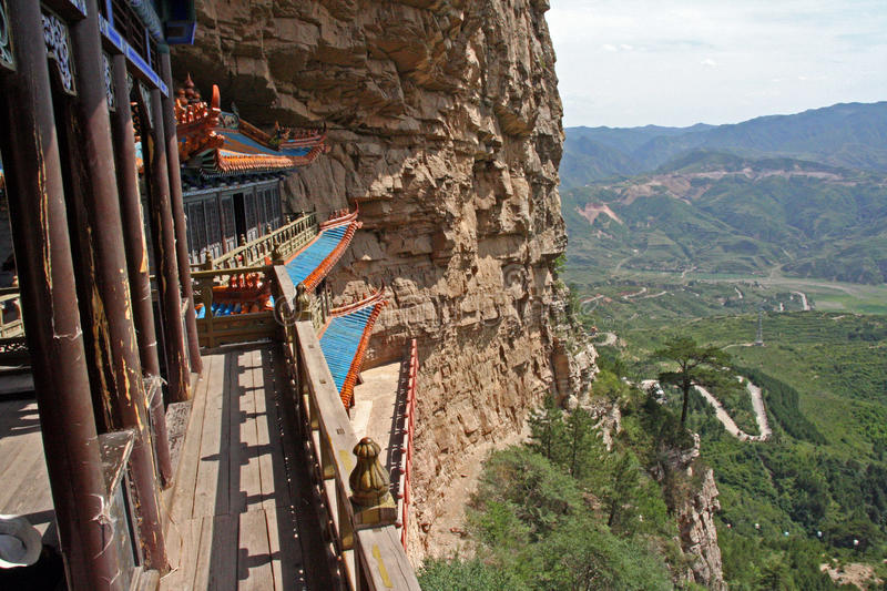 Parts of a Heng Shan Taoist temple complex in North China, near. A Taoist temple carved in rock with large vistas of space below in North China, near Datong stock photos