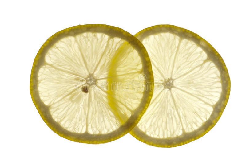 Parts minces de citron photo stock