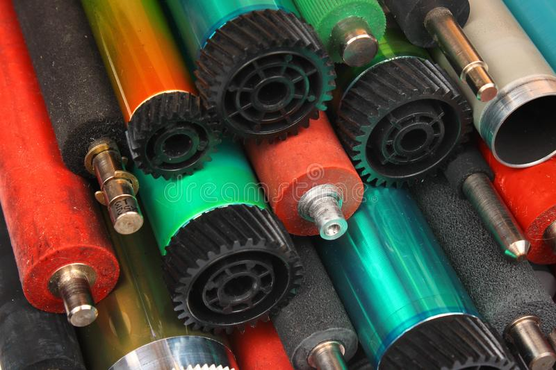 Parts of old laser printers. Photosensitive drums, rubber and metal shafts and rollers royalty free stock images