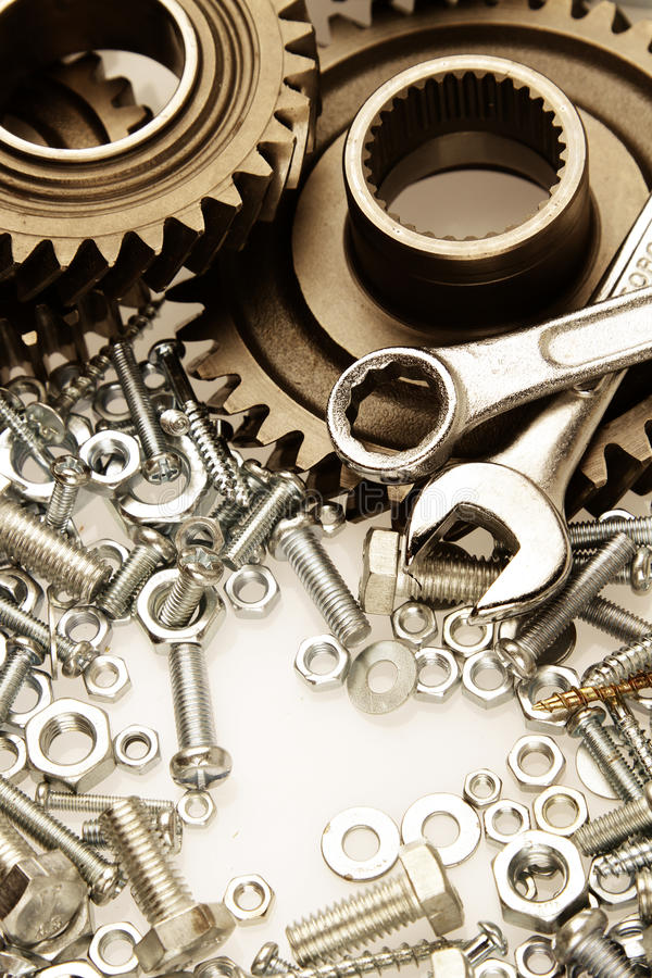 Parts. Steel gears, nuts, bolts, and wrenches stock photo