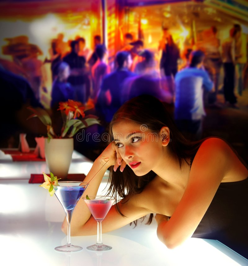 Party. Woman drinking cocktail during a party
