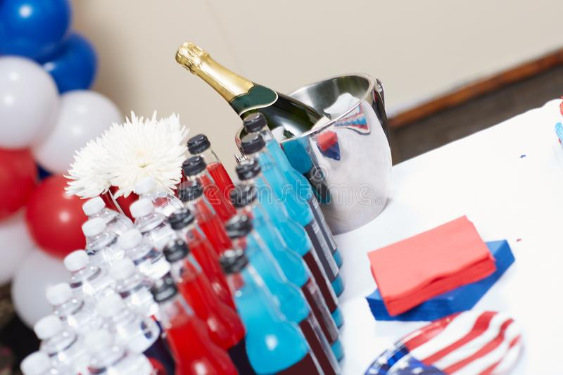 Party arrangement with drinks for Independence Day. Close-up of party arrangement with various soft drinks next to a bottle of champagne for Independence Day stock images