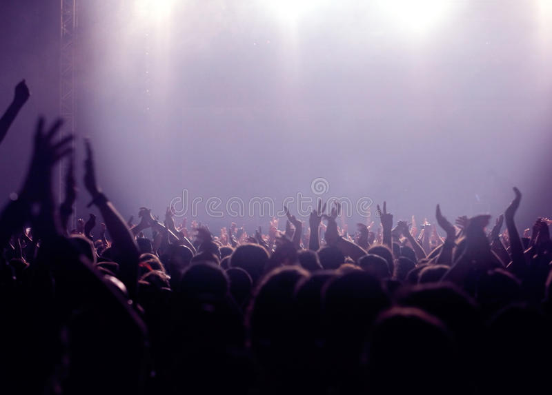 Party audience or concert crowd in violet stock image
