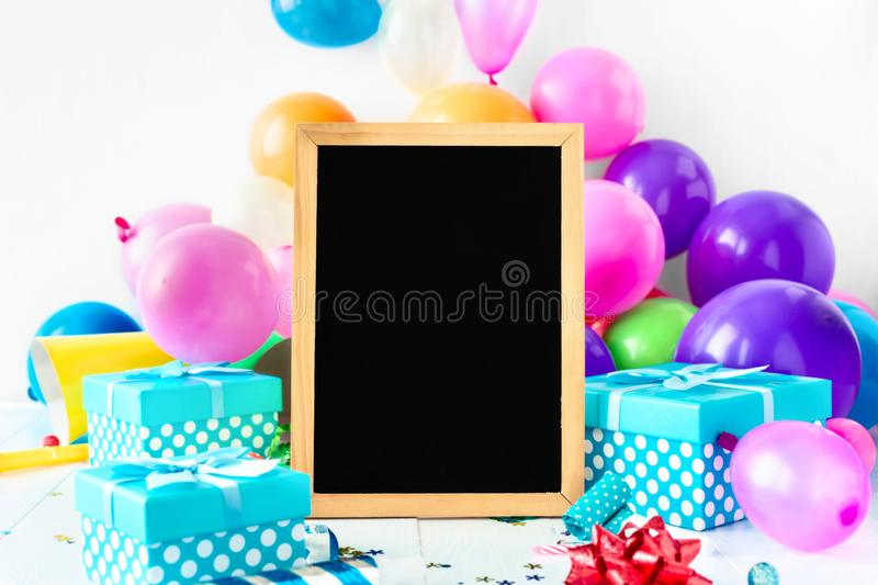 Party Background Balloons Chalkboard Party Decoration Confetti Serpentine Gift. Party Background Balloons Chalkboard With Party Decoration Confetti Serpentine royalty free stock photos