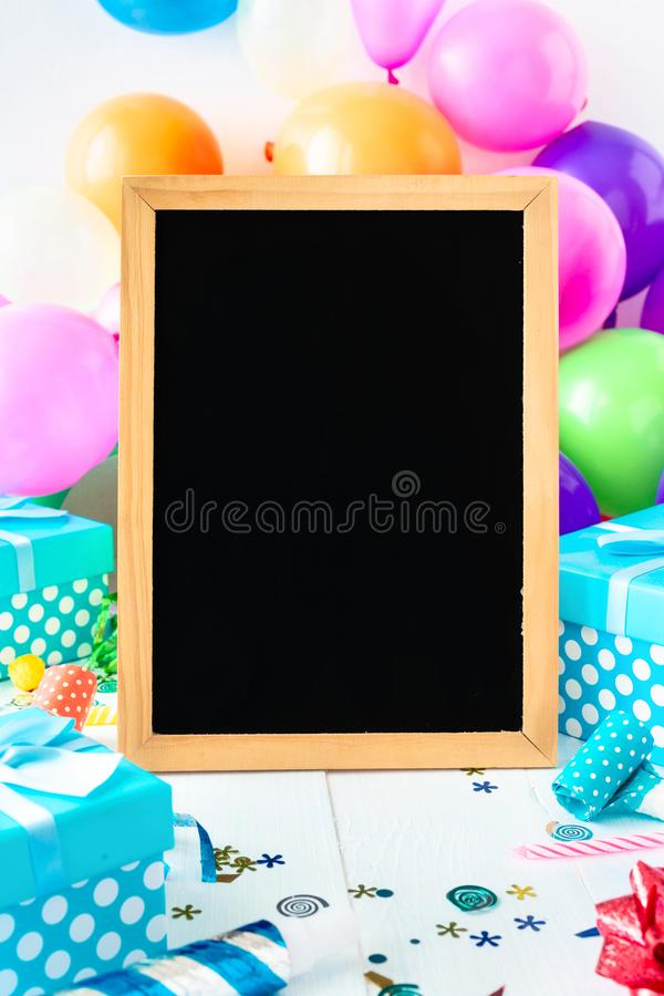 Party Background Balloons Chalkboard Party Decoration Confetti Serpentine Gift. Party Background Balloons Chalkboard With Party Decoration Confetti Serpentine royalty free stock photo