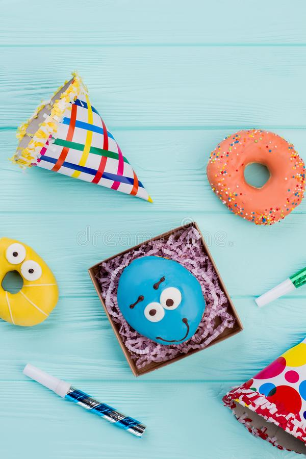 Party background with donuts and Birthday items. stock photography