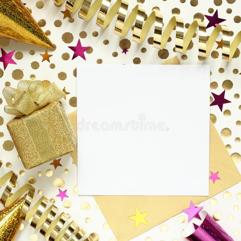 Party background with gift box, gold and purple confetti, serpentine and empty paper for text royalty free stock images