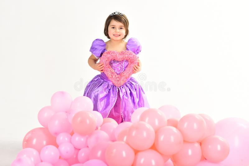 Party balloons. Valentines day. Happy birthday. Kid fashion. Little miss in beautiful dress. Childhood and happiness. Childrens day. Small pretty child hold stock images