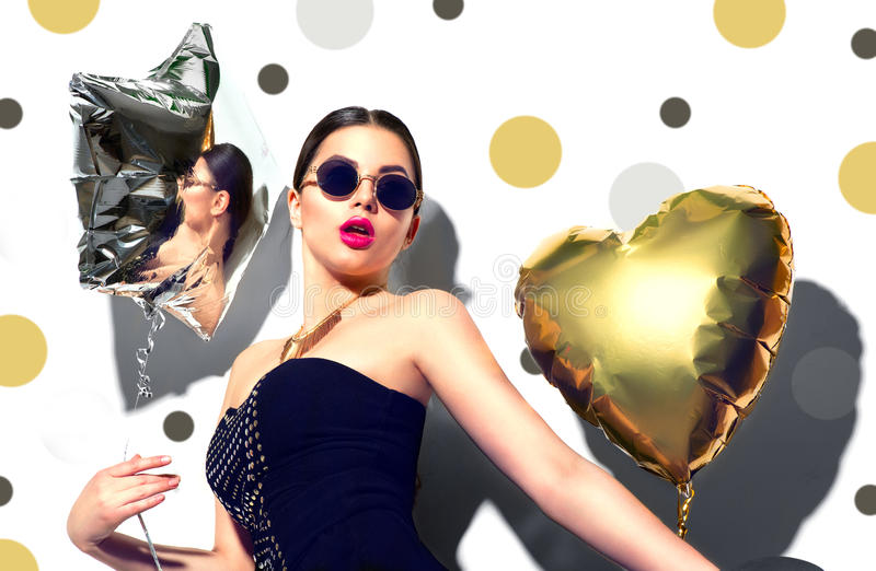 Party. Beauty model girl with colorful heart and star shaped balloons stock photography